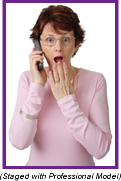 Woman on phone with shocked expression on her face (Staged with profesisonal model).